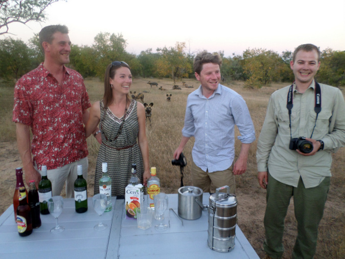 Guests with wild dogs in the background