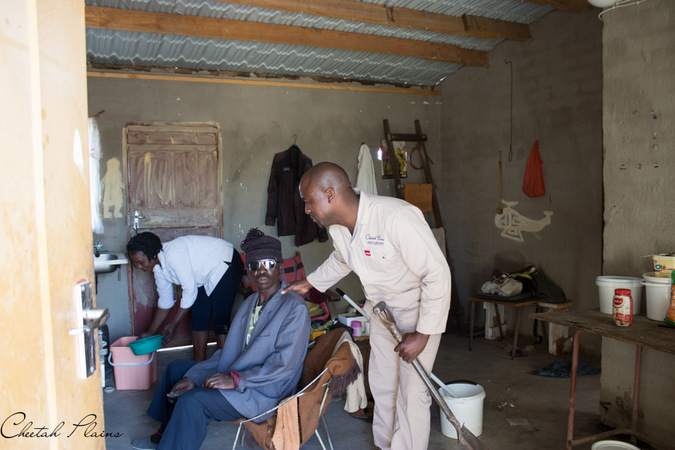 cleaning a house on Mandela Day, Sabi Sand, South Africa