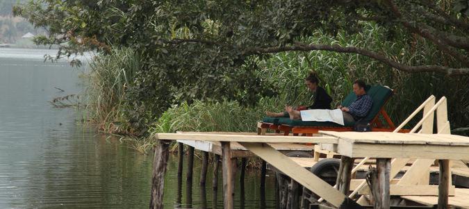 relaxing by Lake Bunyonyi, Uganda