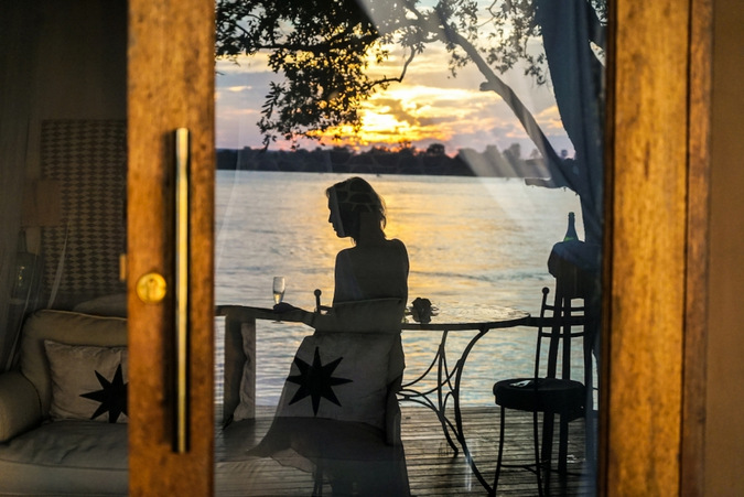reflection, glass door, Zambezi River, Zambia