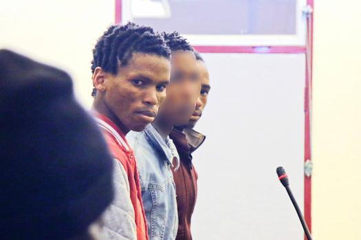 men await trial in court