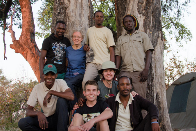 The family and guides pose for a photo in the Okavango Delta