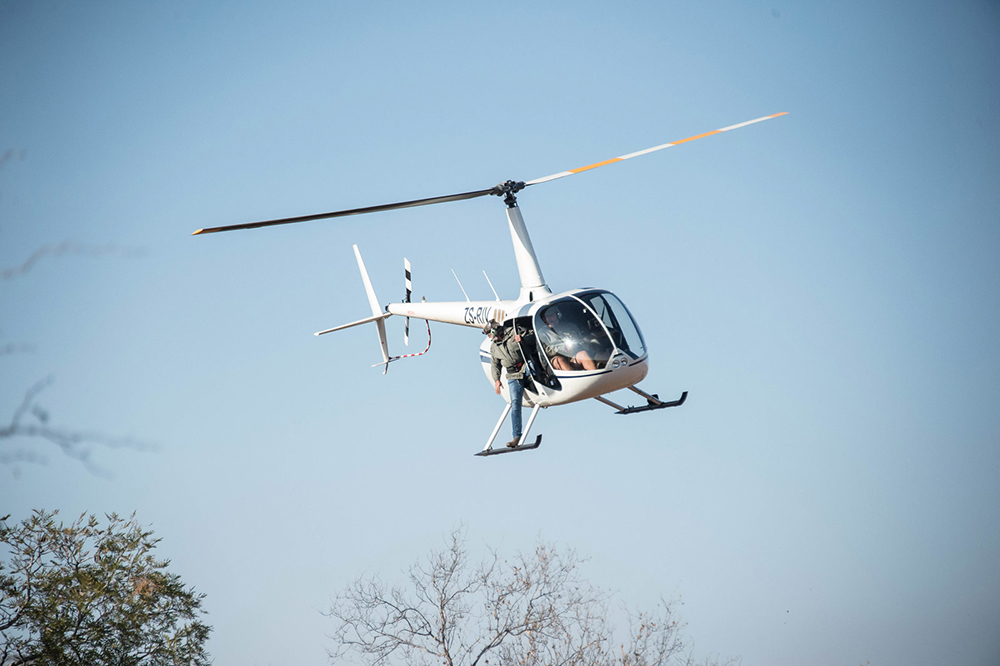 Professional pilot flying a helicopter in the bush