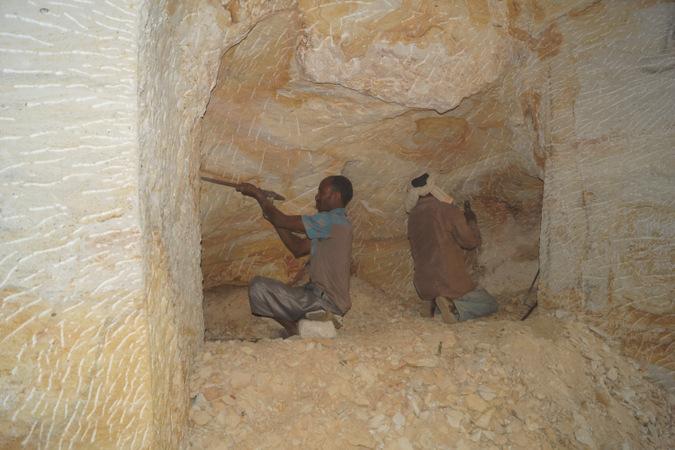 Workmen chiselling rock in Ethiopia