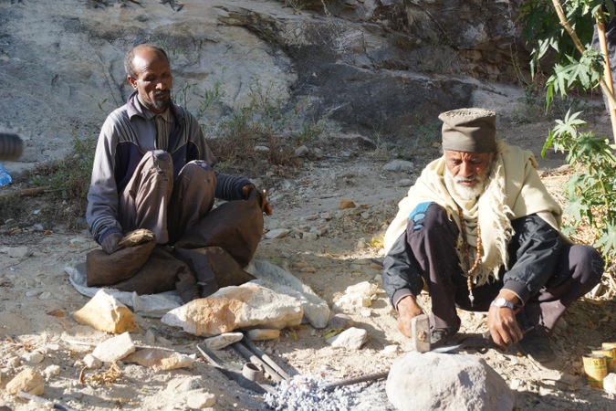 Two men preparing for rock chiselling