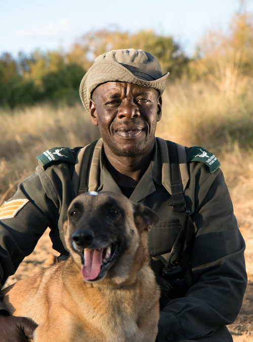 A photo of Lucky Ndlovu with his canine friend