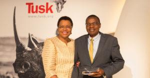 Mrs Graça Machel awards Brighton Kumchedwa at the Tusk Awards