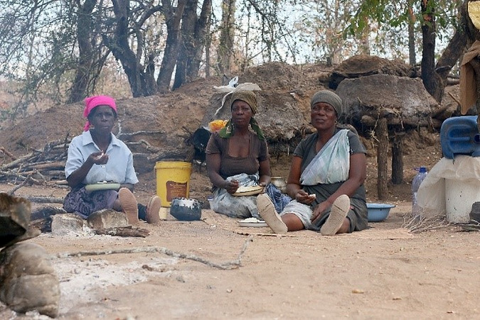 Women take a time out in the Baleni Cultural Camp in Limpopo, South Africa