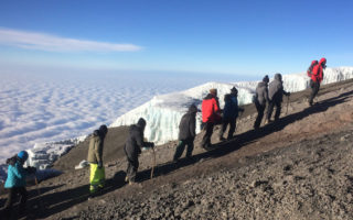 Hiking up Mount Kilimanjaro, past one of the glaciers
