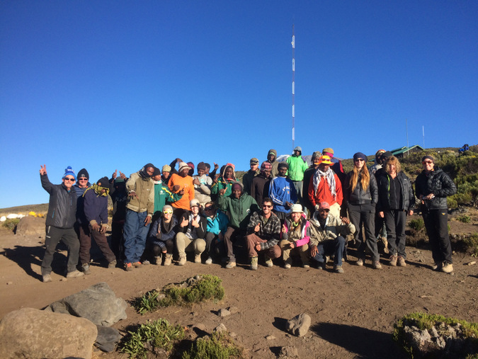 The whole crew... trekkers, guides and porters on Mount Kilimanjaro