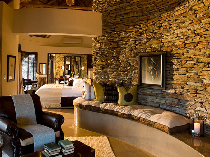 Luxury amenities and bed in a game lodge