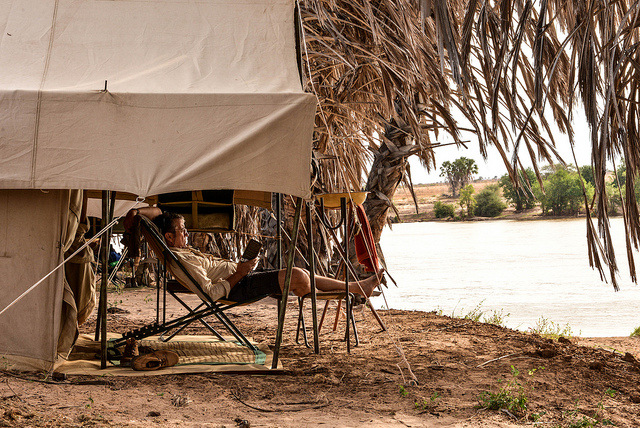 Tent accommodation on safari by a river
