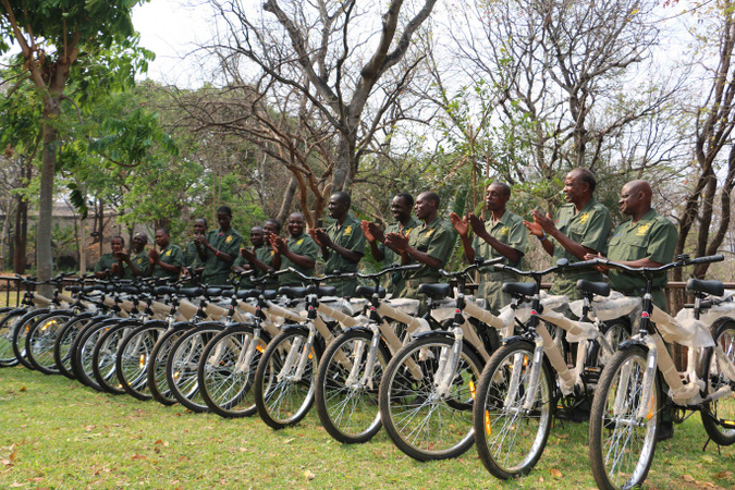 Row of anti-poaching scouts with their new bicycles