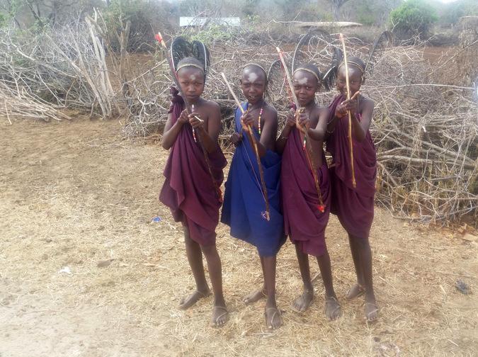 Four young Maasai warriros