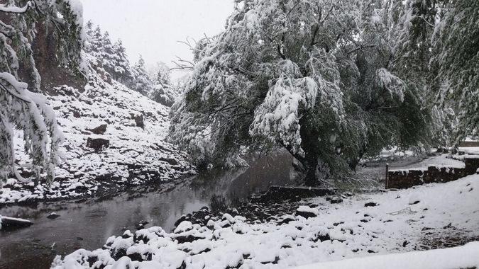 Heavy snowfall in Lesotho, frozen river