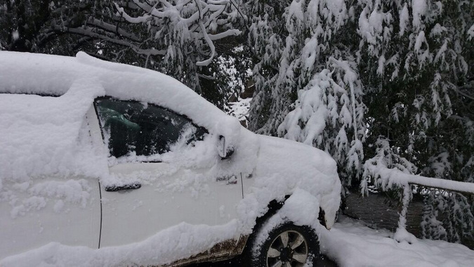 Heavy snowfall in Lesotho, car covered in snow