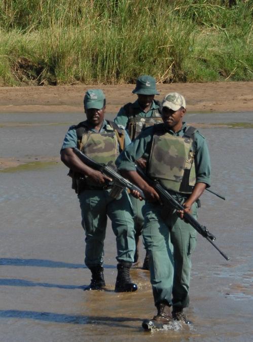 Three rangers on patrol in Hluhluwe iMfolozi Park in KwaZulu-Natal, South Africa