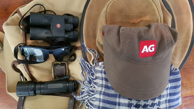 Torch, sunglasses, hat, scarf, binoculars, items to take on safari