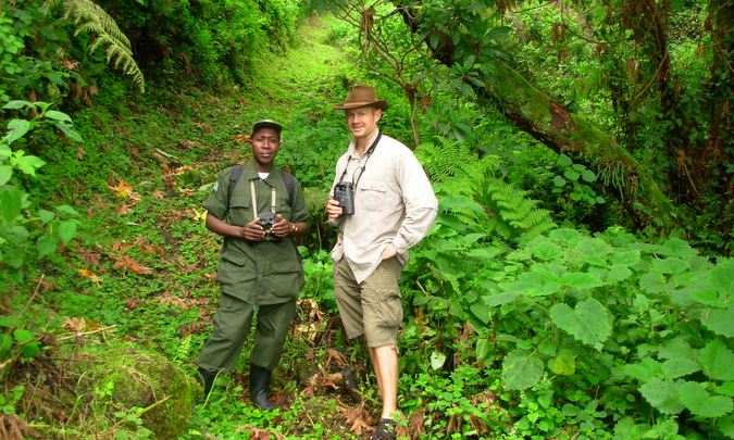 Trekker and guide in Mgahinga Gorilla National Park