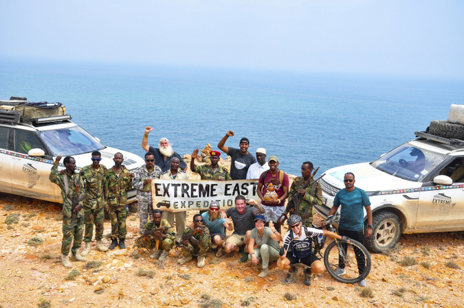 Expedition team members celebrating at the Horn of Africa
