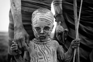 A Karo tribe child in the Omo Valley, Ethiopia © Paolo Maccarone