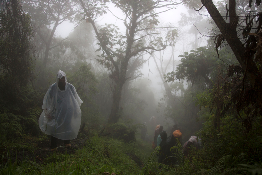 Group member wearing a rain coat