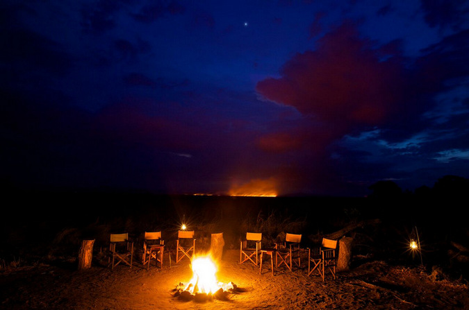 Fire pit with chairs in a wildlife camp in Tanzania