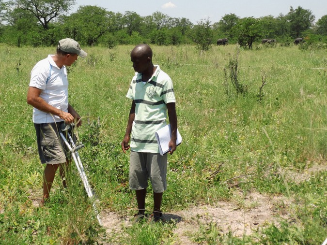 Researches in the field in Botswana with elephant in background