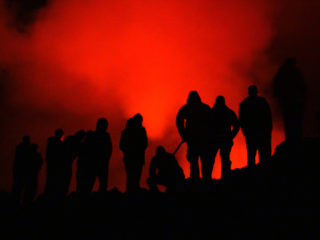 'Glow' – campers gaze down on the lava lake of Mount Nyiragongo in Virunga National Park, DR Congo © Greg Presto