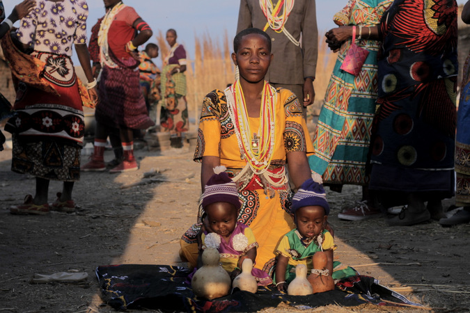 Sukuma woman with two children in her village in Tanzania