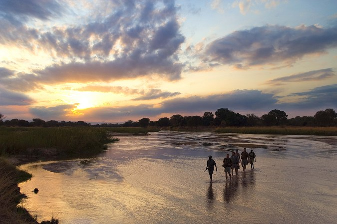 Walking across a river in Africa