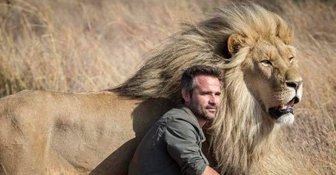 Kevin Richardson with one of the lions at his sanctuary