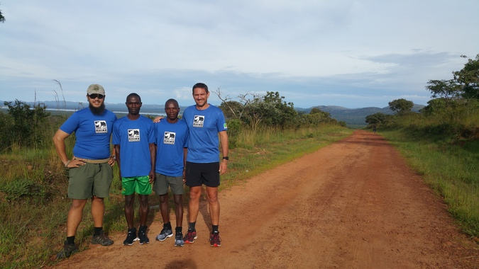 Four runners posing for a photograph in North Luangwa, Zambia