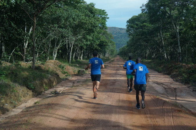 Three people running in North Luangwa, Zambia