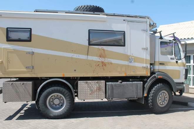 Camper van with blood after leopard attacks man