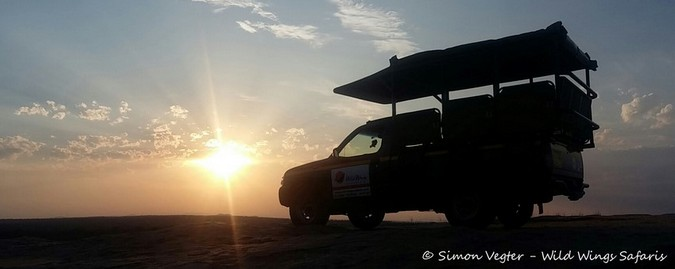 game viewing vehicle at sunset, Kruger National Park, South Africa