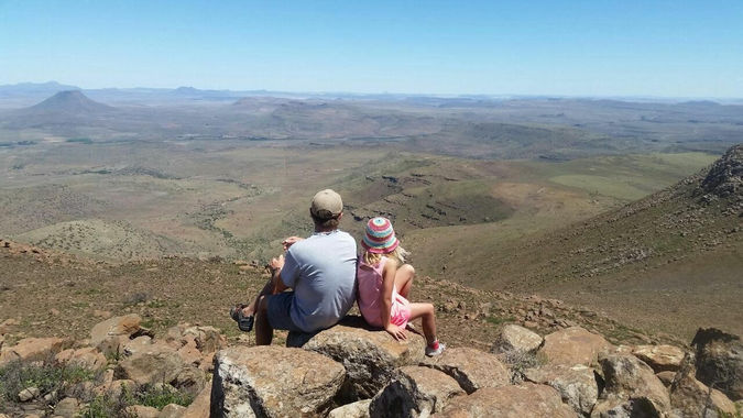 The view of the landscape with two people at Karoo Lodge Conservancy, Karoo, South Africa