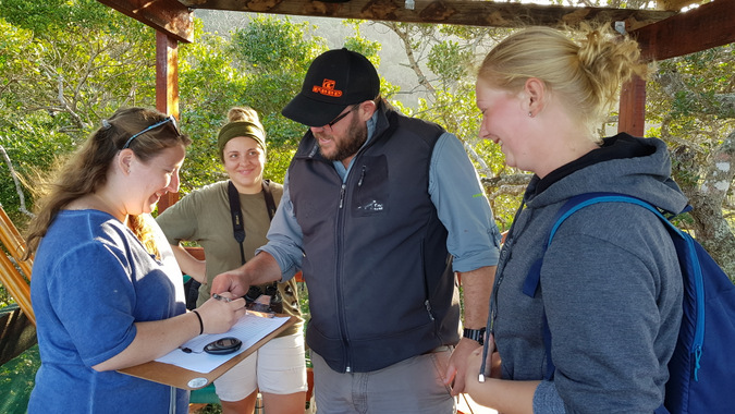 Volunteers collecting humpback whale data in South Africa
