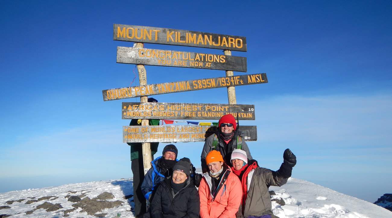 Summit of Mount Kilimanjaro with climbers