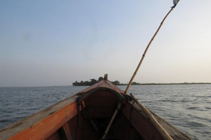 Boat approaching Bakei, Turtle Islands, Sierra Leone