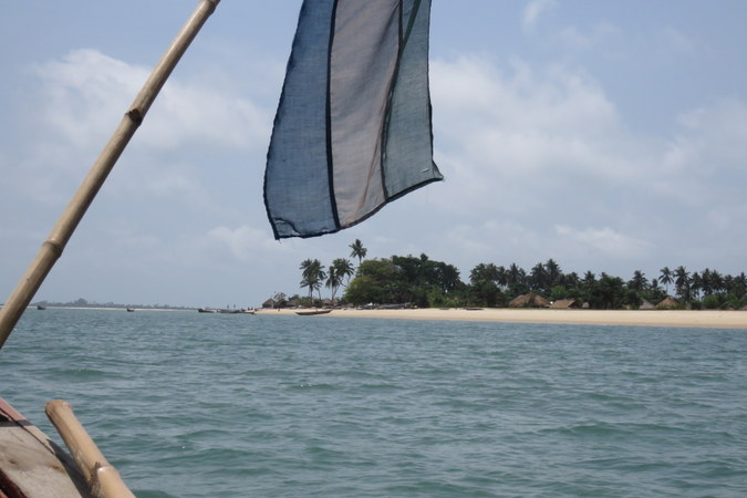 Flag, village and huts on Bumpetuk, Turtle Islands, Sierra Leone