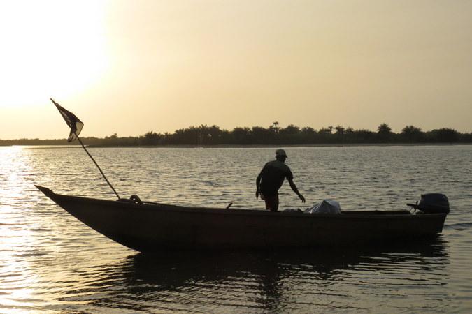 Mr Moses on the boat in Bakei, Turtle Islands, Sierra Leone