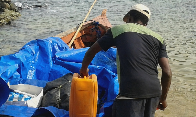 Mr Moses preparing the boat for Turtle Islands, Sierra Leone