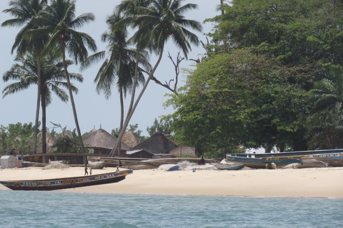 Boats and village at Bumpetuk, Turtle Islands, Sierra Leone