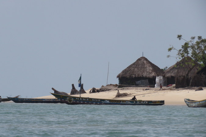 Boats, village and huts on Bumpetuk, Turtle Islands, Sierra Leone