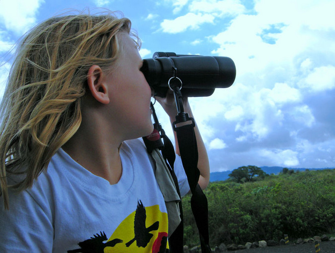 Kid with binoculars while on safari