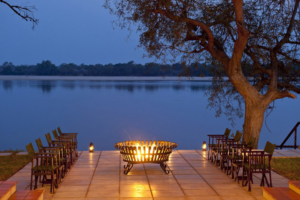 Zambezi River with firepit in foreground at sunset