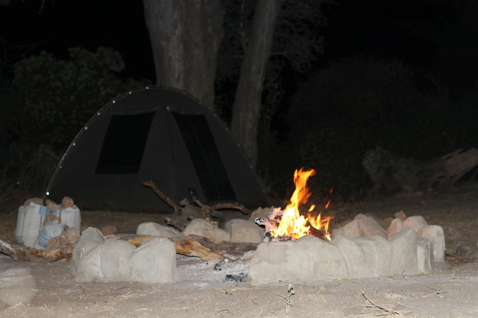 Camp fire at camp in Selous Game Reserve in Tanzania