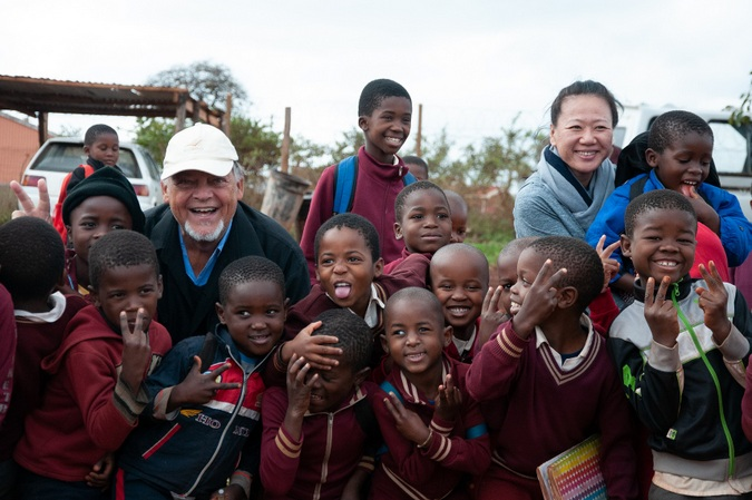 Dr Liu Jing and Prof Jan von Holstein with learners at a local school