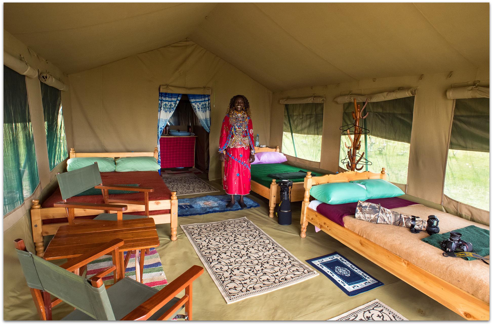 Inside a tent in the Maasai Mara with Maasai woman